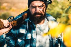 Poacher in the Forest. Hunting Licenses. Hunting is the practice of killing or trapping animals. Hunter with shotgun gun. On hunt. Closed and open hunting royalty free stock images