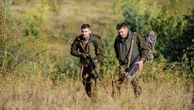 Poacher partner in crime. Activity for real men concept. Hunters gamekeepers looking for animal or bird. Illegal hunting. Hunters friends enjoy leisure stock images