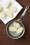 Poaching the quenelles Stock Photo