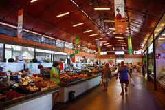 Indoor food market, Olhao. Shoppers looking at the fresh produce for sale in the indoor market, Olhao, Algarve, Portugal, Europe stock photo