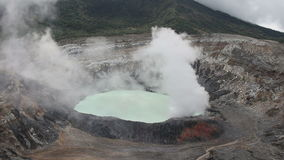 The Poas Volcano in Costa Rica emits a cloud of gas .