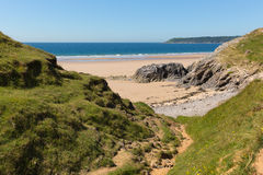 Pobbles beach The Gower Peninsula Wales uk popular tourist destination and next to Three Cliffs Bay in summer Royalty Free Stock Photos