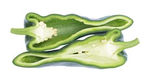 Poblano pepper. Organic chopped poblano peppers on white background stock image