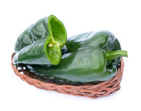 Poblano pepper. S in bamboo basket isolated on white background royalty free stock photo