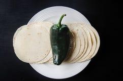 Poblano pepper. And mexican tortillas stock photos