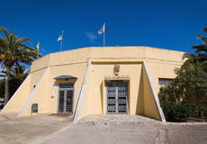 Poblense entrance building with flags. SA POBLA, MALLORCA, SPAIN - APRIL 3, 2016: CD Poblense entrance building with flags, emblems and palm trees with blue sky Royalty Free Stock Image