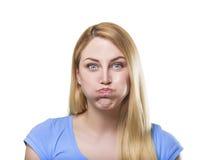 PoBlonde woman making pout Stock Image