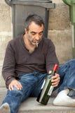 Pobre hombre bebido Foto de archivo libre de regalías