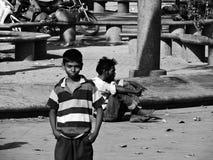 Pobres pero sonrisa Foto de archivo libre de regalías