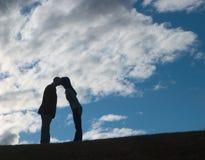 pocałunek na zachód słońca Zdjęcia Royalty Free