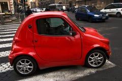 Poca automobile rossa Fotografie Stock Libere da Diritti