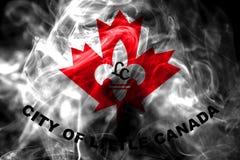 Poca bandera del humo de la ciudad de Canadá, estado de Minnesota, Estados Unidos de fotografía de archivo