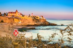 Poca Beach in Estoril, Portugal at Colorful Sunset stock images