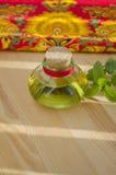 Poca botella de aceite Foto de archivo libre de regalías