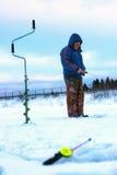 Poca canna da pesca di inverno Immagine Stock Libera da Diritti