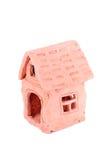 Poca casa de la arcilla roja aislada en blanco Fotografía de archivo libre de regalías