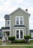 Poca casa gris Fotografía de archivo