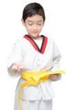 Poca correa del amarillo del arte marcial del muchacho del Taekwondo Fotos de archivo