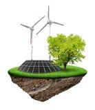 Poca isla con el panel solar y las turbinas de viento Fotografía de archivo libre de regalías
