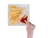 Poca mano che prende le patate fritte Immagine Stock