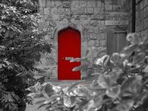 Poca puerta roja Imágenes de archivo libres de regalías