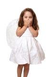Poca ragazza di angelo con le mani che coprono la sua bocca Fotografie Stock Libere da Diritti