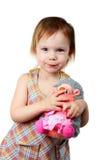 Poca ragazza di bellezza con l'istrice del giocattolo Fotografia Stock Libera da Diritti
