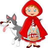 Poca riunione del cappuccio di guida rosso con un lupo Fotografia Stock