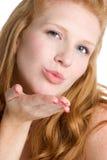pocałunek podmuchowa kobieta Zdjęcia Royalty Free