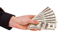 Pocas cuentas de los dólares de los E.E.U.U. en la mano masculina Foto de archivo libre de regalías