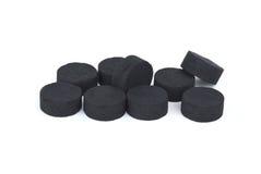 Pocas píldoras activadas del carbón Imágenes de archivo libres de regalías