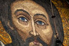 Mosaic of Jesus Christ. Pochaev , Ukraine - 05.04.2015 Christian mosaic with image of Jesus Christ on the wall of the Trinity Cathedral in Pochaev Lavra stock image