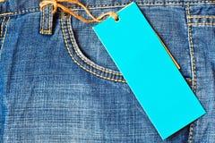 Poche de jeans avec l'étiquette blanc Photo libre de droits