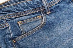 Poche sur des jeans images stock