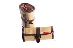 Poches brunes roulées avec des crayons Photographie stock libre de droits