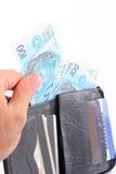 Pochette avec de l'argent Photos stock