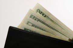 Pochette avec de l'argent Photographie stock