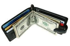 Pochette avec des dollars Photographie stock libre de droits