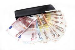Pochette avec les billets de banque européens Photo stock
