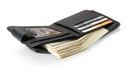 Pochette en cuir noire avec des dollars. Image libre de droits