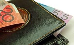 Pochette et billets de banque noirs Photos stock