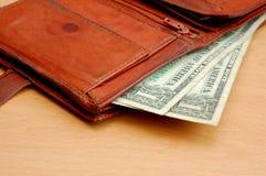 Pochette et dollars 1 Photographie stock