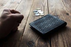 Pochette et pièces de monnaie images libres de droits