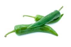 Pochi peperoni di peperoncino rosso verdi Fotografia Stock Libera da Diritti