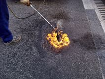 Pochodnia płomienia powierzchni droga obraz royalty free