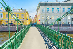 On Pochtamtsky Bridge in St Petersburg. The view on Pochtamtsky Bridge (Postal) across the Moyka River, named after Central Post Office (Pochtamt), St Petersburg Royalty Free Stock Photo