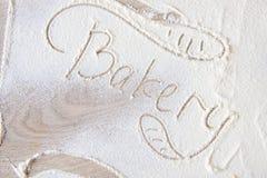 Pociągany ręcznie słowo piekarnia na stole obrazy stock