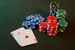 Pocket Aces. Two Aces on a poker table with stacks of chips stock photo