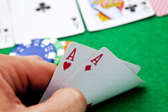Pocket aces on a casino table Stock Photos