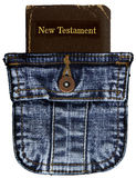 Pocket Bible. This is a vintage New Testament in a denim pocket royalty free stock images